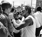 A confrontation between an unidentified African American man and an Ohio National Guard soldier on Wooster Avenue during the July 18, 1968, riot in Akron, Ohio. From the Akron Beacon Journal photo files