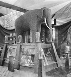 Fruit and nuts exhibit showing an elephant made of English walnuts, California Building, Alaska-Yukon-Pacific-Exposition, Seattle, Washington, 1909. Photo by Frank H. Nowell. PH Coll 727.264