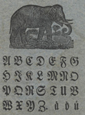 The broadside contains a complete alphabet of capital letters in Fraktur type and three lower case letters, followed by a four line verse beginning, 