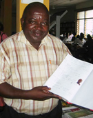 Professor Tete displays the Kinshasa Municipal Library's patron register