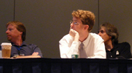 Matt Gullett, John Blyberg, and Jed Moffitt watch Tom Peters's Second Life slides at Wiking the Blog and Walking the Dog. Photo by Rick Roche